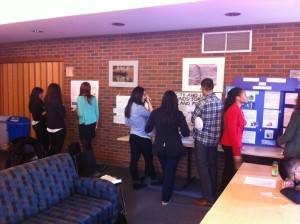 Student research posters being examined by conference attendees